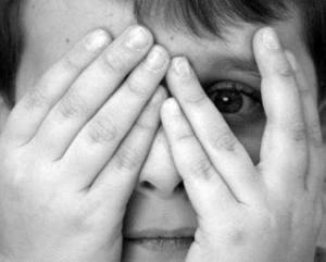 shame-child-face-hiding